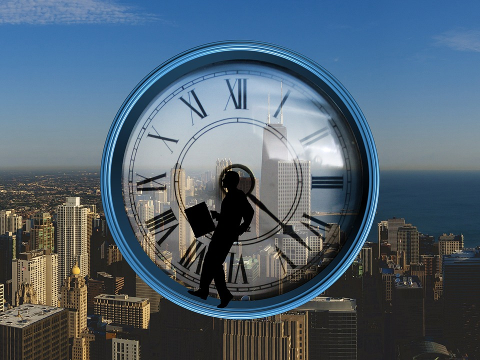 Silhouette of businessman working around the clock.