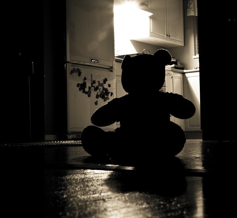 Darkened silhouette of teddy bear depicting child sexual abuse